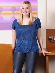 Big Boobed H Cup Holly wearing blue jeans and a top whips out her massive mams