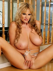 Kelly fingers herself in blue lingerie and silver body jewelry.