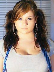 Busty Teen Tara poses in her kitchen wearing a tartan skirt and bra