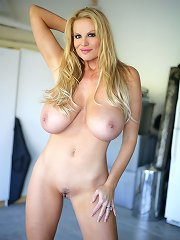 Kelly cleans her garage like no other naked and ends up making a juicy mess between her legs.