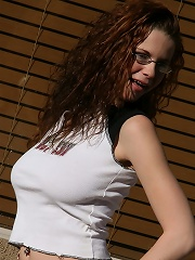 Redhead Holly strips outside