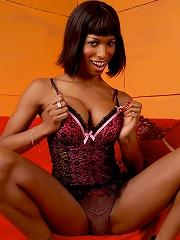 Horny ebony transsexual posing in naughty lingerie
