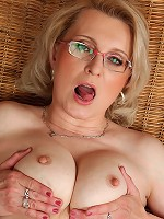 Hot blonde MILD Margeaux in spicy red lingerie spreads her pussy