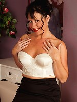 Mature babe Elise Summers wearing only white stockings.