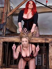 Mistress Jemstone spanks busty Sapphire and fingers her cunt