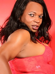Killer black tgirl in leather panties and red top