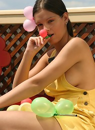 SweetEva playing with balloons in the garden