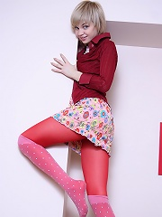 Pretty teen in red stockings and pink socks