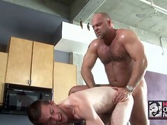 Hairy muscle bear fucks brutally a younger stud