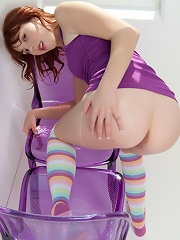 Bubbly Delila Darling in her purple tops and rainbow socks spreading her sweet wet cherries on the chair
