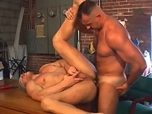 Bear takes a break from hard work to give this guy's ass some hard work with his cock