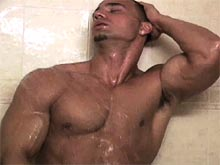 Gay muscle man shows his perfect body and jerks off his hard cock