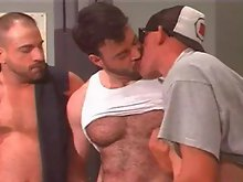 Three muscle hairy studs have hot group sex