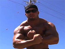 Strong muscle man Adam Reich posing nude