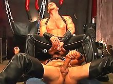 Clad in leather outfits, these two studs couldn't keep their mouths off of their dicks