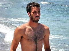 Big muscled dude is topless showing off his hairy chest