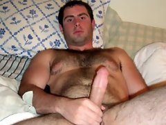 Gay dude is naked then sits on the dildo stretching his ass