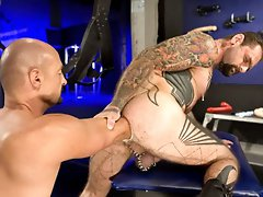 Tattooed muscle guy gets his ass fisted hard