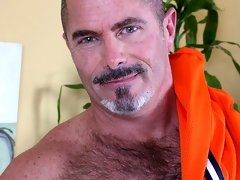 Big, mature and hairy Tim Kelly playing with FleshJack in this solo videos