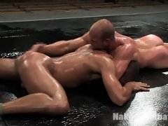 Hot muscular studs fight with hard cocks in oil.