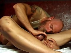 It turns his man on to see him in rubber clothes, so he fucks his butt with it on