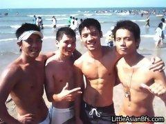 Asian boyfriends on a beach