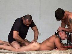 Muscle top fucks this lad's face while another one fists his ass in bondage