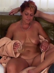 The sultry granny welcomes them to her place with a drink and then they all fuck hard