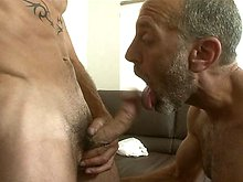 Hairy older gay sucking a muscle hard cock