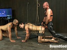 Josh West fucks two boys in bondage and cums all over them during a live shoot.