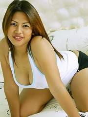 Thai bar girl with big tits poses for photos before sucking cock!