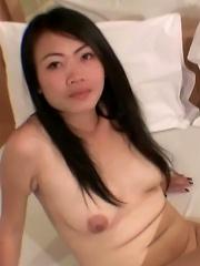 Very pretty amateur Thai girl named Gitar takes cum in her mouth