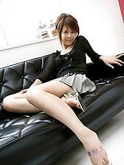 Sakurako hot and sexy Asian teen shyly shows her big tits in her bikini top
