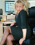 Office boss flashes her nylons