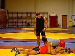 Wrestlers blow their hard bodied trainer