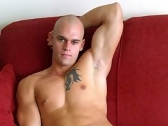 Hunky stud plays with cock