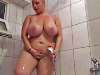 Big Titted Blonde Is Taking A Shower