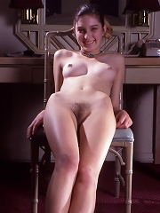 Petite young woman totally nude, exposed, and waiting.