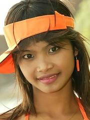 18 year old Thai teen in orange bikini at the beach