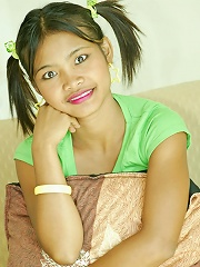 Asian Amateur Tussinee in pigtails gets naked