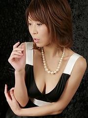 Hot Japanese milf Jun Kusanagi in stockings