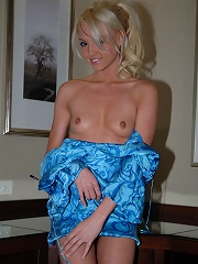 Kelly strips out of her sexy blue dress.