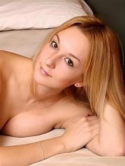 pillow hugging (nudity)