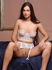 Long Legged brunette posing naked and gracefully