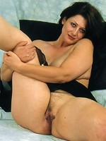 Gorgeous brunette mature grabing her pussy