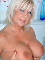 Busty milf Patsy exposing pink