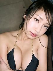 Saucey asian babe is erotic in a skimpy leopard print bikini