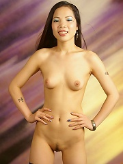 Sexy perfect boobed asian babe doing a hot striptease