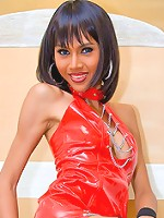 Killer t-girl in red PVC gown and stripy stockings