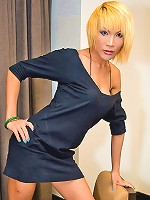 Blonde ladyboy Natalie showing her smashing assets
